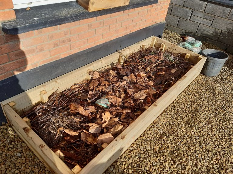 Building a raised bed - leaves and rotten wood