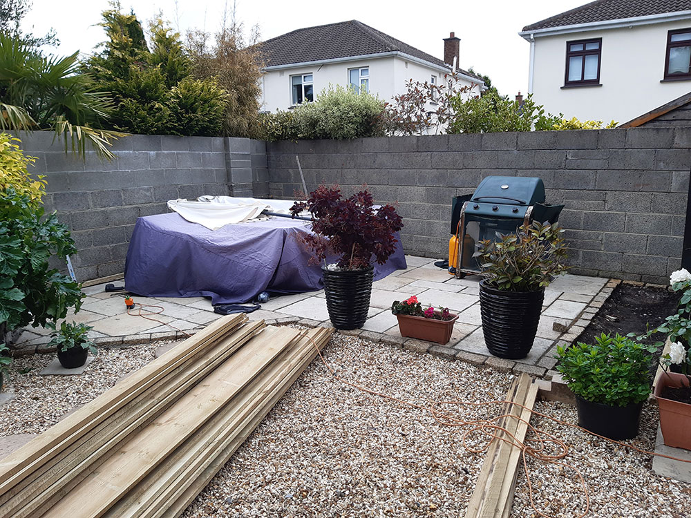 Cladding garden wall with timber - before
